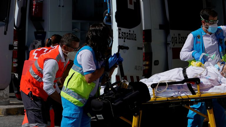 Emergency crews treat a patient in Madrid