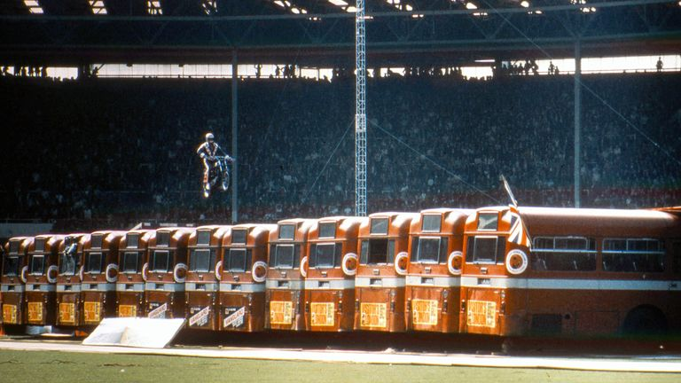American daredevil Evel Knievel (1938 - 2007) makes a motorcycle jump over thirteen AEC Merlin buses at Wembley Stadium in London, 26th May 1975. The stunt ended in a crash in which Knievel broke his pelvis. (Photo by Kypros/Getty Images)