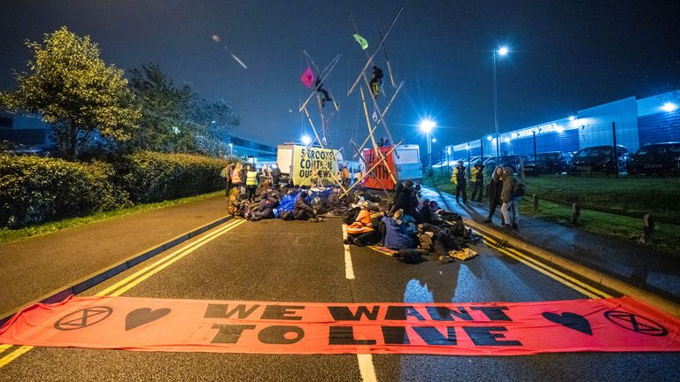 Extinction Rebellion activists block the entrance to Newsprinters facility in Broxbourne, Hertfordshire, Britain September 4, 2020. Pic: Extinction Rebellion UK/ Reuters