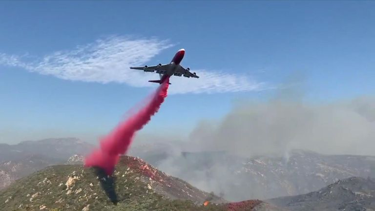 """Eight air tankers are working to douse California's Valley Fire, officials said, as it shows """"rapid rates of spread"""""""