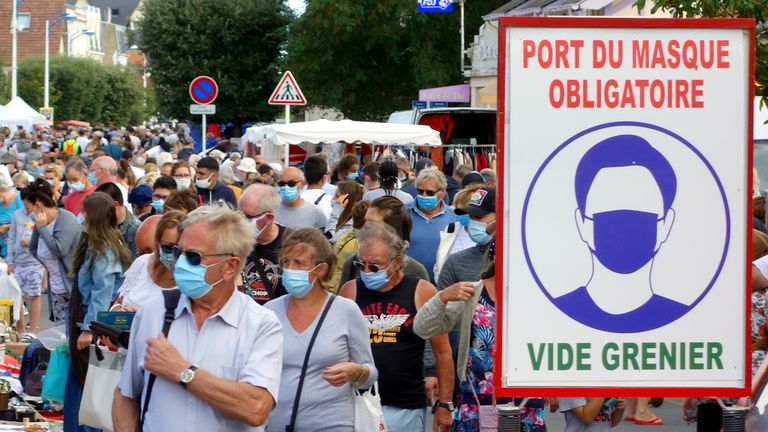 People wear masks at a flea market in Merville-Franceville-Plage, France