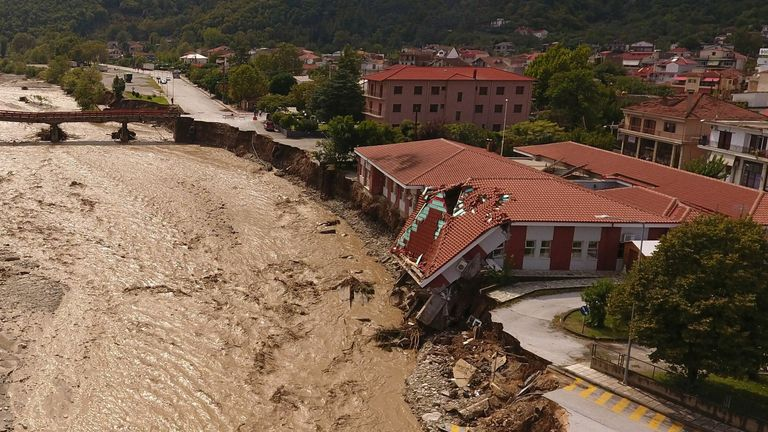 A  medical centre partially collapsed next to the flooded Pamisos river in the town of Mouzaki,