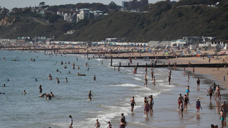 People enjoy the sunshine on Bournemouth beach at the start of this week's mini-heatwave
