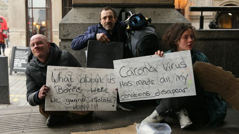 March: Homeless people hold up signs for help as the coronavirus crisis begins to escalate