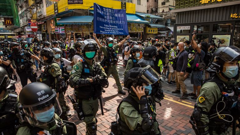 Police patrol the area after protesters called for a rally in Hong Kong on September 6, 2020 to protest against the government's decision to postpone the legislative council election due to the COVID-19 coronavirus, and the national security law