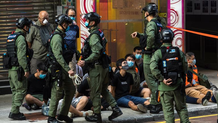 Police detain people as they patrol the area after protesters called for a rally in Hong Kong on September 6, 2020 to protest against the government's decision to postpone the legislative council election due to the COVID-19 coronavirus, and the national security law. - Nearly 100 people were arrested by Hong Kong police on September 6 as riot officers swooped on democracy protesters opposed to the postponement of local elections
