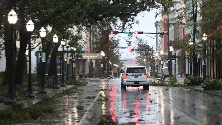 Hurricane Sally Makes Landfall On Gulf Coast MOBILE, ALABAMA - SEPTEMBER 16: A police vehicle drives through a street strewn with tree branches as the winds and rain from Hurricane Sally pass through the area on September 16, 2020 in Mobile, Alabama. Mr. Hollyhand evacuated from his home to spend the night in the hotel. The storm is bringing heavy rain, high winds and a dangerous storm surge to the area. (Photo by Joe Raedle/Getty Images)