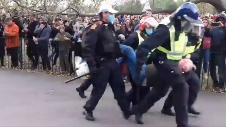Police carry a man away from anti-lockdown protests in Hyde Park, which moved on from Trafalgar Square earlier on Saturday 26/09/20.