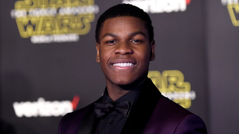 "John Boyega attends the premiere of Walt Disney Pictures and Lucasfilm's ""Star Wars: The Force Awakens"" on December 14th, 2015 in Hollywood, California."