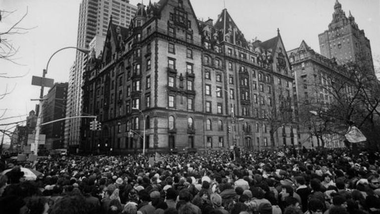 Crowds gather outside Lennon's New York home after his murder in December 1980