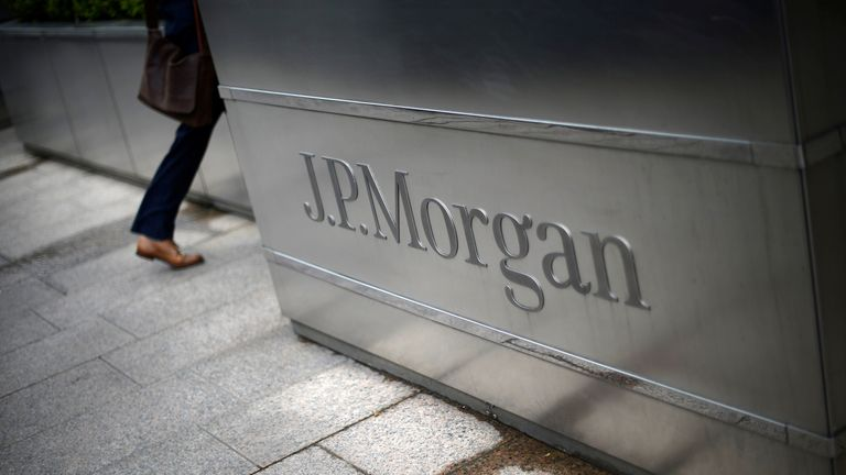 """A man walks into the JP Morgan headquarters at Canary Wharf in London May 11, 2012. REUTERS/Dylan Martinez/File Photo GLOBAL BUSINESS WEEK AHEAD PACKAGE - SEARCH """"BUSINESS WEEK AHEAD JULY 11"""" FOR ALL IMAGES"""