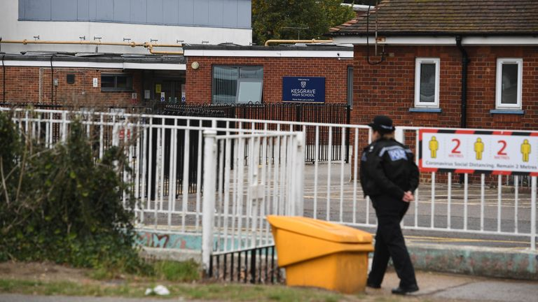 A police officer is pictured outside the victim's school in Kesgrave