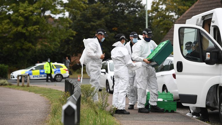 Forensic officers are pictured at the shooting scene