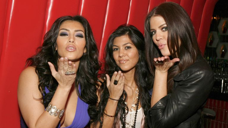 Kim, Kourtney and Khloe Kardashian pose at a viewing party in 2007