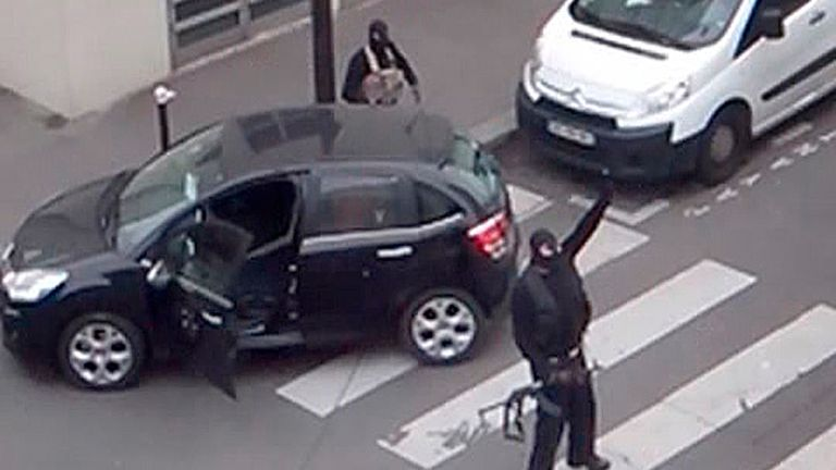The gunmen gesture after carrying out the shooting