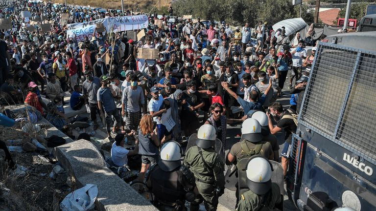 Migrants protesting in front of a police blockade near the town of Mytilene