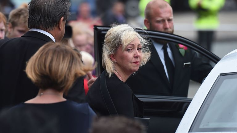 Lisa Roussos is seen at Saffie's funeral in 2017
