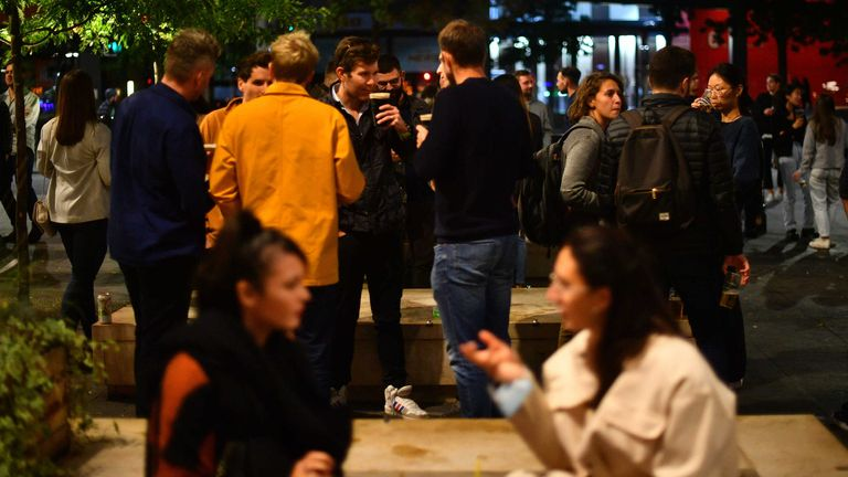 People gather at a bar near London Bridge