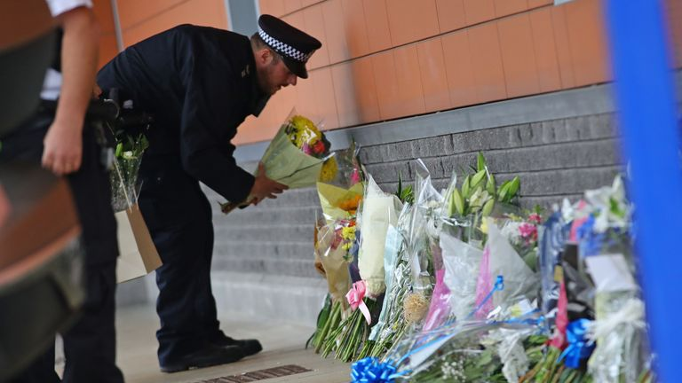 Police lay flowers outside Croydon custody centre