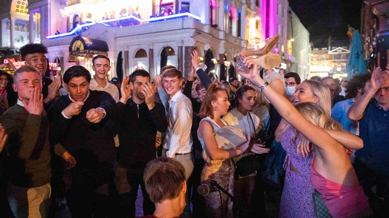 People in London's West End make enjoy a night out before the 'rule of six' ban on large gatherings comes into force