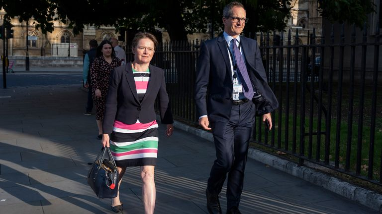 Lord Bethell, seen with Head of NHS Test and Trace Dido Harding, walking through Parliament Square
