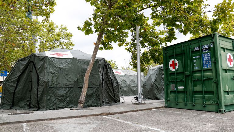 Triage tents installed outside a Madrid military hospital
