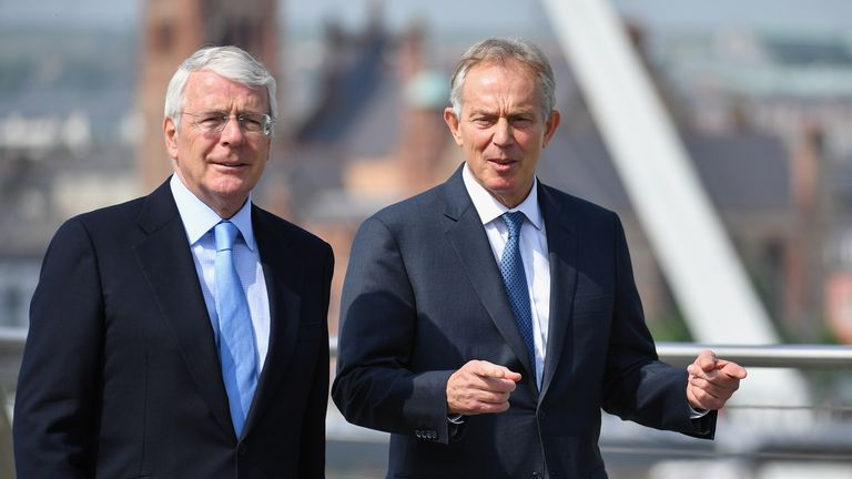 Sir John Major and Tony Blair speak as they walk across the Peace Bridge on June 9, 2016 in Derry, Northern Ireland.