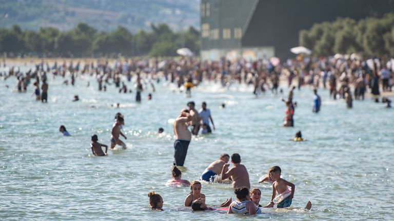 People cool off at the Menekse beach in Istanbul, Turkey