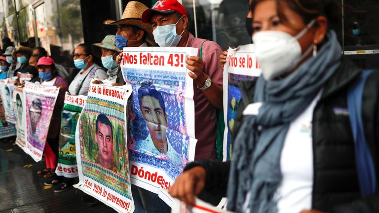 Relatives of missing students hold posters with their images as they take part in a protest outside the Attorney General's office, before the sixth anniversary of the disappearance of 43 students of the Ayotzinapa Teacher Training College, in Mexico City, Mexico September 25, 2020. REUTERS/Henry Romero