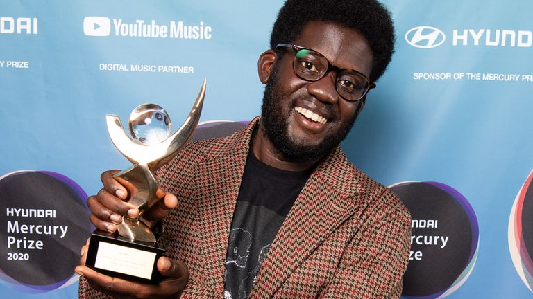 Michael Kiwanuka holds up his Album of the Year prize