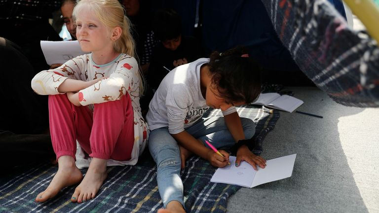 Children sit in a tent on a road near the new temporary camp near Kara Tepe, Mytilene, Greece. Pic: Dimitris Tosidis/EPA-EFE/Shutterstock