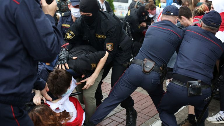 Police are seen detaining students during a protest in Minsk