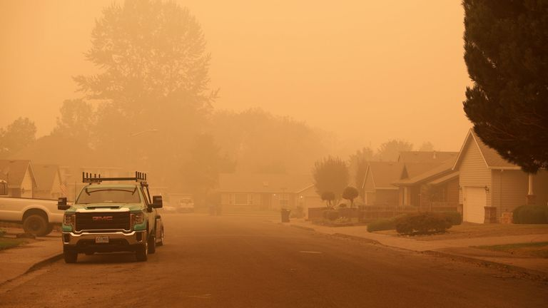 An orange smoke-filled sky is seen above Molalla, Oregon, on September 10, 2020, as fires burn nearby.