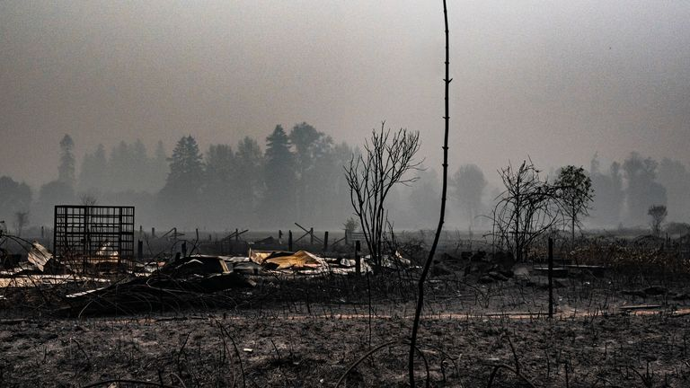 A spot fire smoulders near a lumber yard on September 10, 2020 in Molalla, Oregon.