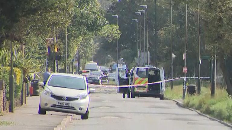 Police forensic team at the scene of a murder investigation into the death of a man who was set on fire
