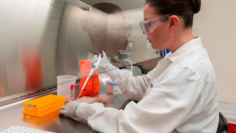 Dr. Rhonda Flores looks at protein samples at Novavax labs in Gaithersburg, Maryland on March 20, 2020, one of the labs developing a vaccine for the coronavirus, COVID-19.