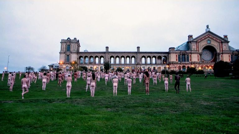 Over 200 people braved the cold to pose naked for a nude art installation by photographer Spencer Tunick at the Alexandra Palace
