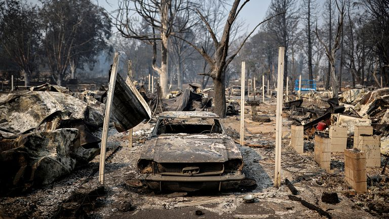 Burned car is seen in a neighbourhood after wildfires destroyed an area of Phoenix, Oregon, U.S., September 10, 2020. REUTERS/Carlos Barria