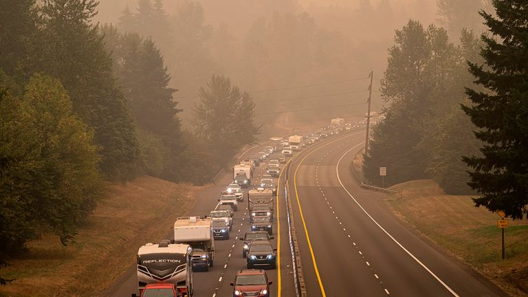 OREGON CITY, OR - SEPTEMBER 10: Oregon residents evacuate north along highway Highway 213 on September 9, 2020 near Oregon City, Oregon. Multiple wildfires grew by hundreds of thousands of acres Thursday, prompting large-scale evacuations throughout the state.  (Photo by Nathan Howard/Getty Images)
