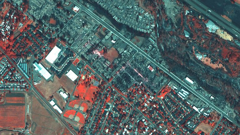 A satellite image shows destroyed homes in Mountain View Estates in Talent, Oregon