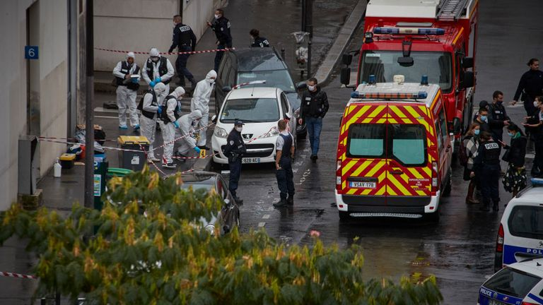 Two people have been left injured after a knife attack near the old offices of Charlie Hebdo