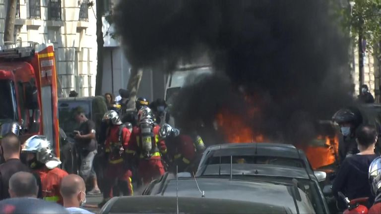 A car was set on fire during protests in Paris today