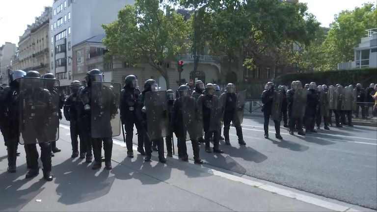 Officers in riot gear are seen on the streets of Paris