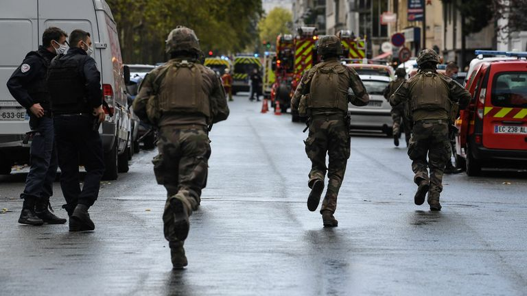 French soliders rush to the scene after several people were injured near the former offices of the French satirical magazine Charlie Hebdo following an alleged attack by a man wielding a knife in the capital Paris on September 25, 2020. - The threats coincide with the trial of 14 suspected accomplices of the perpetrators of the massacres at Charlie Hebdo and a Jewish supermarket that left a total of 17 dead. (Photo by Alain JOCARD / AFP) (Photo by ALAIN JOCARD/AFP via Getty Images)
