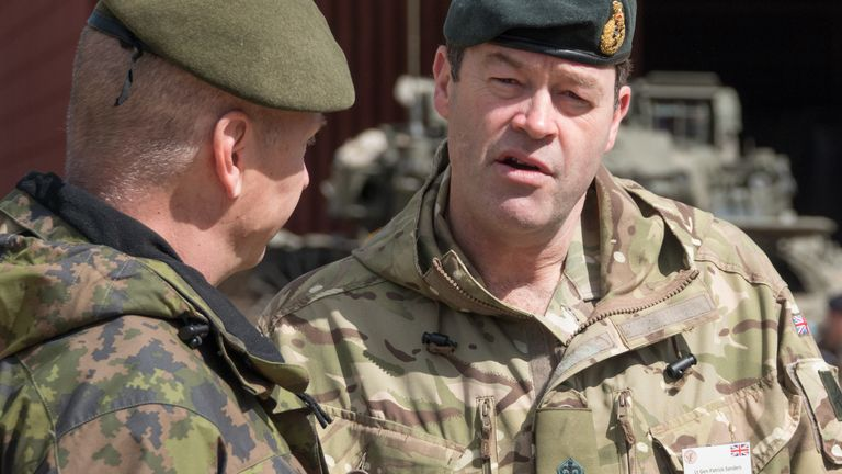 Lieutenant General Patrick Sanders, Commander Field Army (R) talks at a live demonstration at the Joint Expeditionary Force (JEF) Live Exercise (LIVEX) Distinguished Visitor Day being held on Salisbury Plain Training Area near Salisbury on May 3, 2018 in Wiltshire, England.