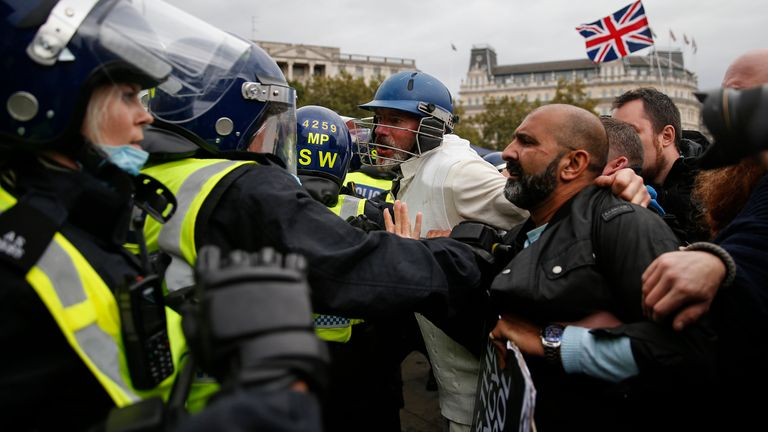 Protesters clashed with police officers during a 'We Do Not Consent' anti-lockdown rally in Trafalgar Square