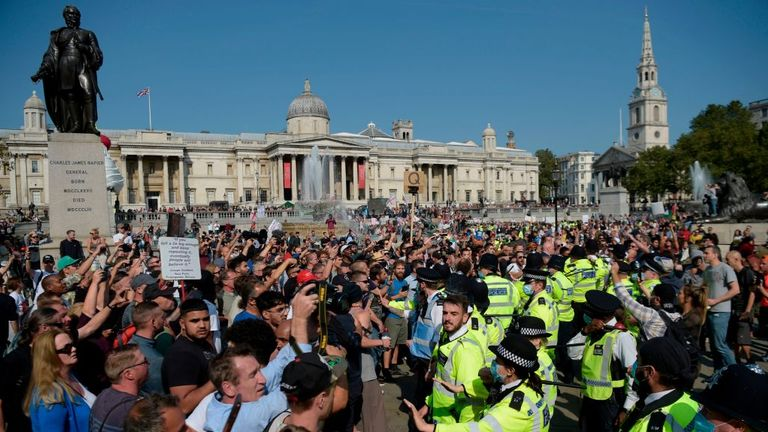 Police hold back protestors at an anti-vax rally in central London on September 19, 2020. (Photo by DANIEL LEAL-OLIVAS / AFP) (Photo by DANIEL LEAL-OLIVAS/AFP via Getty Images)