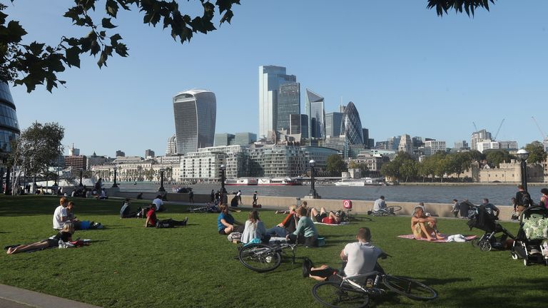 People enjoying the warm weather in Potters Fields Park, London.