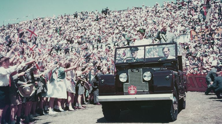 Queen Elizabeth and Prince Philip wave to well-wishers during a Commonwealth visit to Australia in 1954
