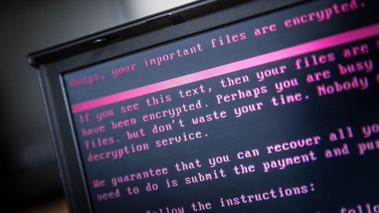 A laptop displays a message after being infected by a ransomware as part of a worldwide cyberattack on June 27, 2017 in Geldrop. The unprecedented global ransomware cyberattack has hit more than 200,000 victims in more than 150 countries, Europol executive director Rob Wainwright said May 14, 2017. Britain's state-run National Health Service was affected by the attack. / AFP PHOTO / ANP / Rob Engelaar / Netherlands OUT (Photo credit should read ROB ENGELAAR/AFP via Getty Images)